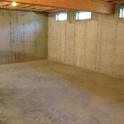 A cleaned out basement in Johnstown, shown before remodeling has begun