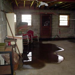 A flooded basement showing groundwater intrusion in Pittsburgh