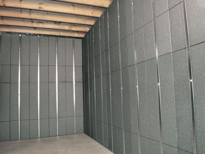 silverglo insulation and metal studs making up our basement to beautiful panels installed